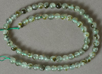 Round beads from light green prehnite.