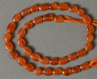 Flat oval beads from red carnelian.