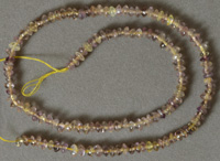 Small light colored ametrine rondelle beads.