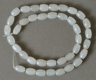 Milky white Jade barrel beads on strand.