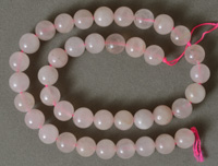 Light colored rose quartz round beads.