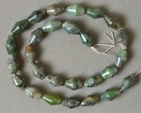 Double cone barrel beads from green zoisite.