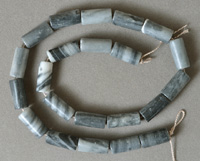 Gray, black and white drum beads from spiderweb Jasper.