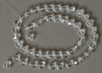faceted round beads from clear Czech glass.