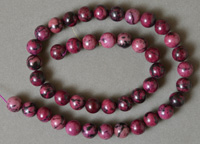 10mm round beads from purple Jade.