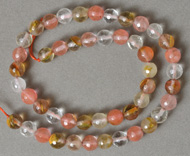 Faceted round beads from watermelon tourmaline.