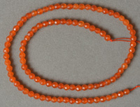 Faceted round beads from South American orange topaz.