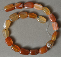 Natural carnelian tumbled nugget beads.