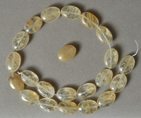 Oval beads from yellow tourmaline.