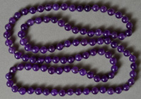 Long necklace from amethyst round beads.