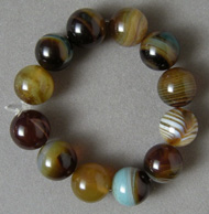 12 round beads from brown and blue agate.