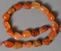 Strand of tumbled carnelian nugget beads.