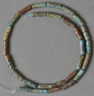 Tube or long drum shaped beads from rainbow calsilica.