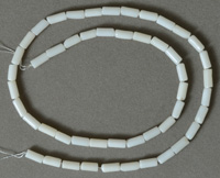 Tube beads from white colored coral.