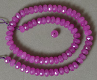 Faceted rondelle beads from purple jade.