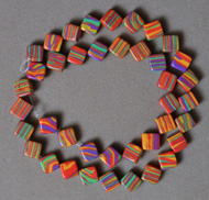 Small square beads from multi color striped turquoise.