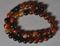 10mm round beads from red to brown dream agate.
